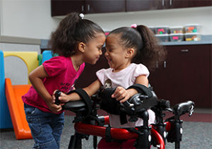 Lansing medical malpractice lawyer discusses how assistive devices can help children with cerebral palsy bond with others.